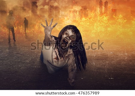 Asian zombie woman is anger, ugly face and fire background