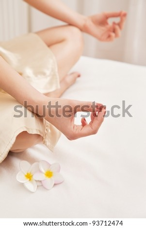 Asien woman relaxing doing yoga sitting - stock photo