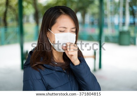 Asisn girl sick and wearing mask - stock photo