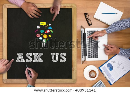ASK US concept Businessman working at office desk and using computer and objects on the right, coffee,  top view, with copy space - stock photo