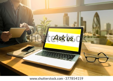 Ask us Contact Information Assistance Advice Concept, Thoughtful male person looking to the digital tablet screen, laptop screen,Silhouette and filter sun - stock photo