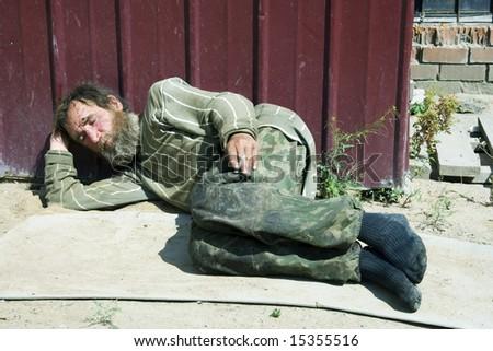 Asleep beggar. - stock photo