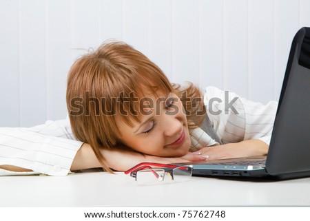 asleep on the job girl. Office. - stock photo