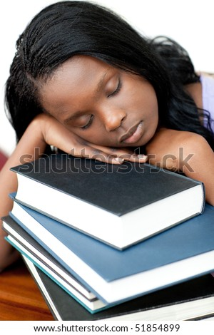 Asleep student leaning on a stack of books against a white background - stock photo