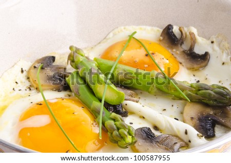 Asparagi with fried egg brown - stock photo