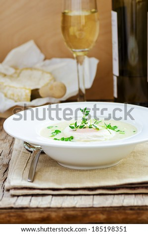 Asparagus and cheese soup with ramson, thyme, camembert cheese and white dry wine - stock photo