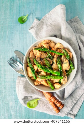 Asparagus and chicken roasted and seasoned with sesam seeds - stock photo