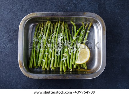 Asparagus baked with lemons and cheese. Top view - stock photo