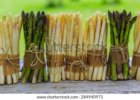 Asparagus - bunches of white and green asparagus - stock photo