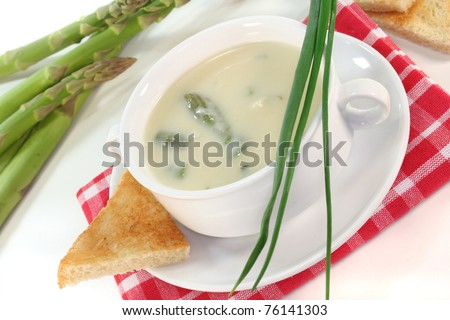 Asparagus cream soup with fresh asparagus, toast and chive - stock photo