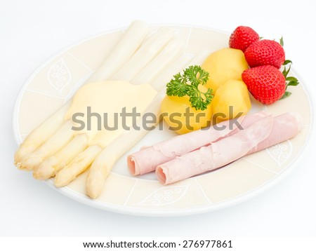 asparagus dish with strawberrys on a plate - stock photo