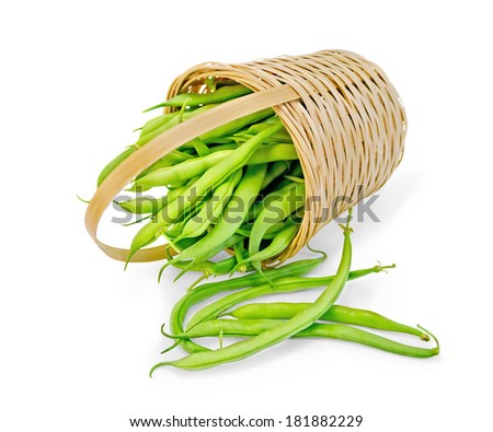Asparagus green beans in a wicker basket isolated on white background - stock photo