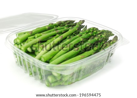 asparagus in plastic container isolated on white background  - stock photo