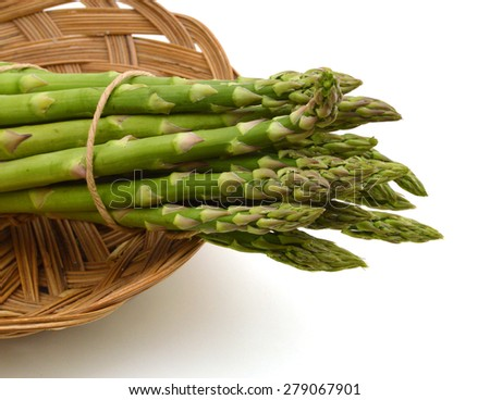asparagus isolated in basket on a white background - stock photo