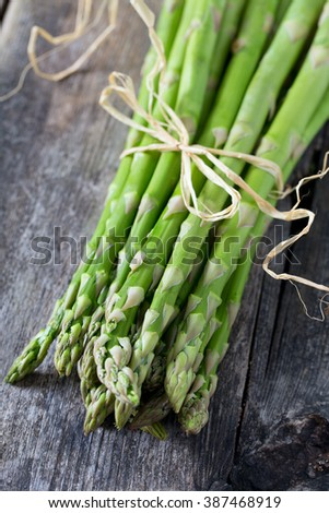 asparagus on wooden surface - stock photo