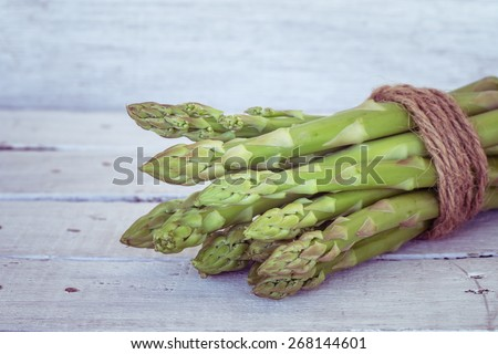 asparagus on wooden table with filter effect retro vintage style - stock photo