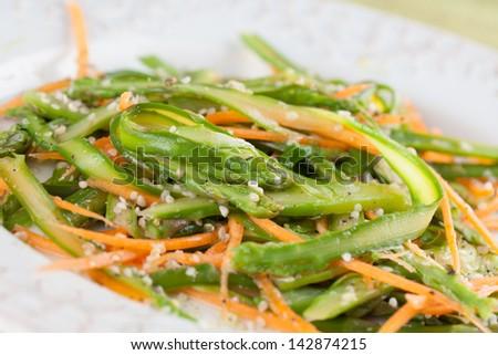 Asparagus salad with carrot and hemp seeds - stock photo