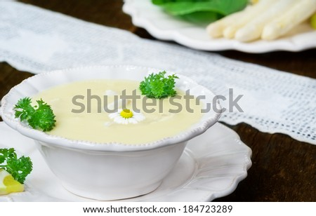 Asparagus soup and white asparagus - stock photo