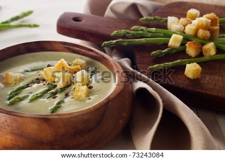 Asparagus soup cream with croutons on white background close-up - stock photo