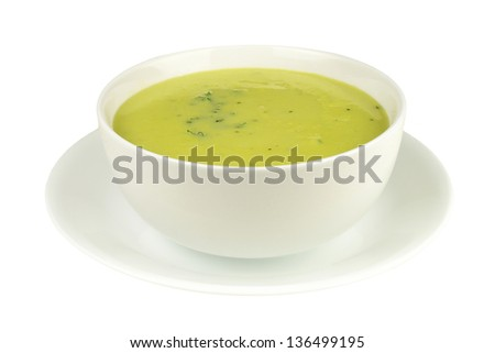 Asparagus soup in a bowl isolated on a white background - stock photo