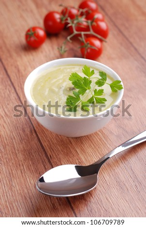 asparagus soup in white bowl on wooden table