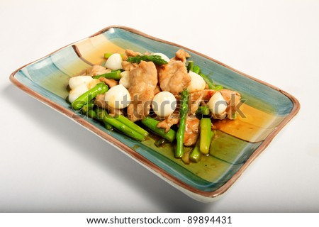 Asparagus stir fried with pork and pickled garlic - stock photo