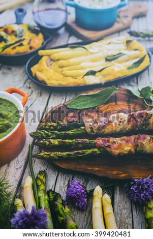 Asparagus - the delights of white and green asparagus, a variety of dishes (filtered) - stock photo