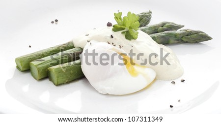 Asparagus with Poached Eggs. - stock photo