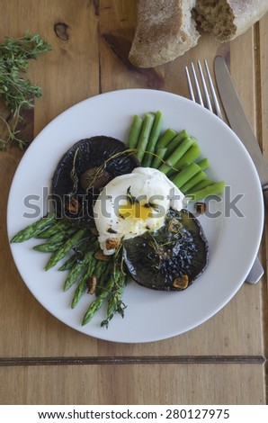 Asparagus with Portobello mushrooms and poached egg - stock photo