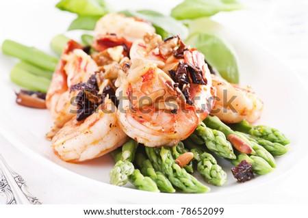 Asparagus with shrimps - stock photo