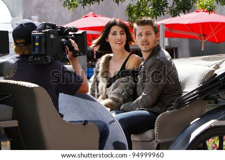 "ASPEN - SEPT 9: Scott Clifton and Jacqueline MacInnes Wood film the CBS daytime drama ""The Bold and the Beautiful"" on location in Aspen, CO on September 9, 2011."