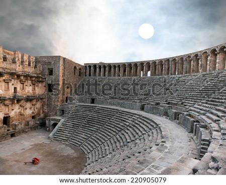 aspendos amphitheater with dramatic sky (Antalya Turkey)  - stock photo