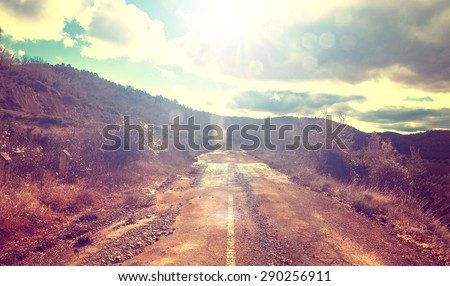 Asphalt and travel concept.Old road and sunset.Vintage style - stock photo