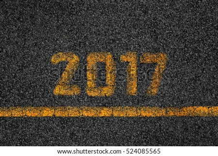 Asphalt background texture with 2017 of New Year