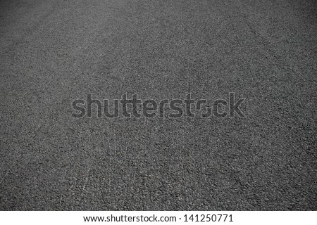 Asphalt dark new surface - stock photo