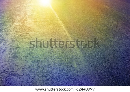 asphalt detail with shiny and colour oil reflections - stock photo