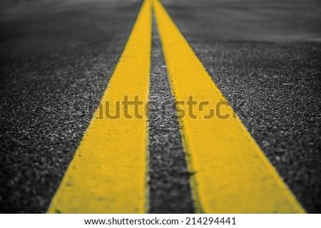 Asphalt highway with yellow markings lines on road  background - stock photo