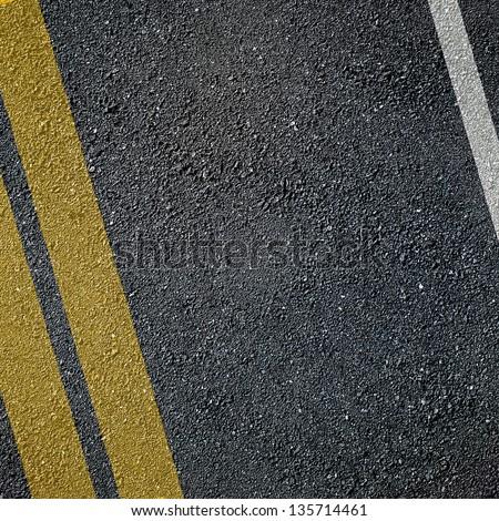 Asphalt lined road surface - stock photo