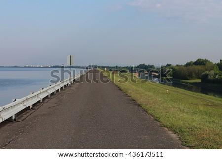 Asphalt pavement on Danube dam in Kyselica, Slovakia - stock photo