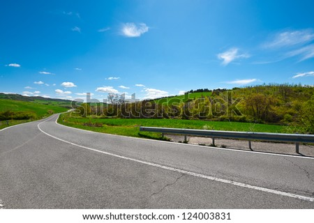 Asphalt Road among the Fields in Umbria, Italy - stock photo