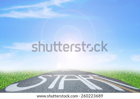 Asphalt road and blue sky - stock photo