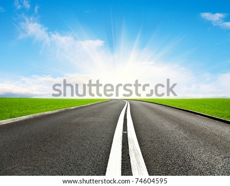 Asphalt road and blue sky - stock photo