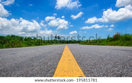 Asphalt road and clouds on blue sky in May 30,2014 - stock photo