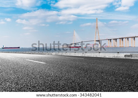 Asphalt road and modern bridge,Hong Kong - stock photo