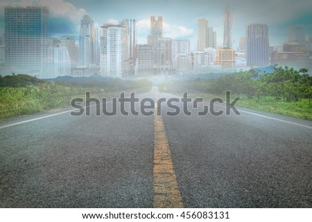 Asphalt road and modern city.Business concept of success industry tech architecture.