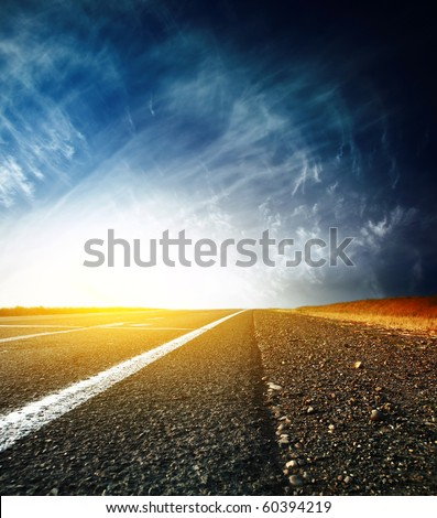 Asphalt road and sky with clouds - stock photo