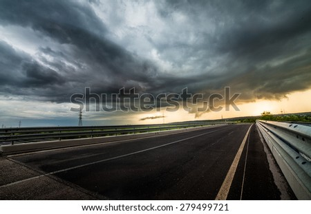 Asphalt road and stormy sky