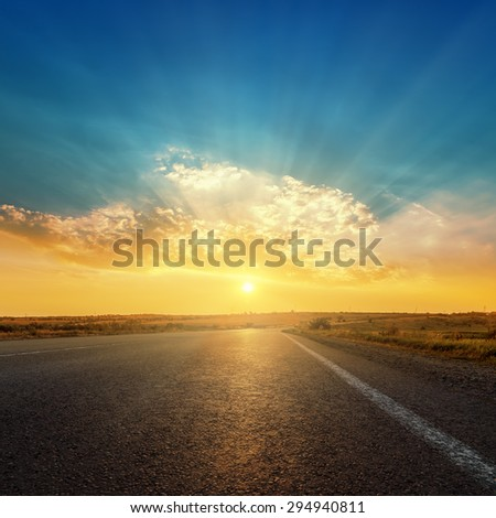 asphalt road and sunset in clouds - stock photo