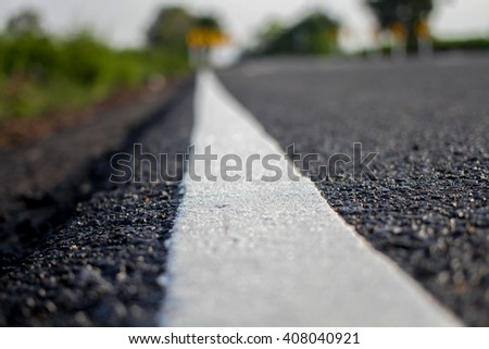asphalt road and white line background with space for text - stock photo