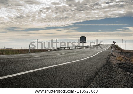 Asphalt road and white line marking. Close up low viewpoint. - stock photo